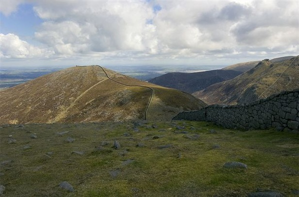 The impressive bulk of Slieve Meelmore, the steep wall up Bearnagh to the right