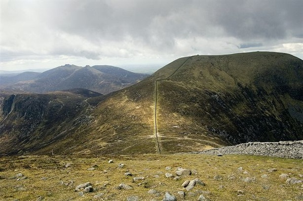 A ray of light catches the gap between Donard and Commedagh