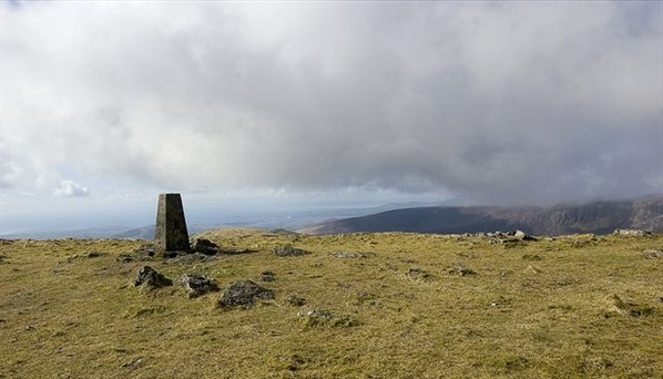 Trig Pillar on Slieve Muck. The Cooleys are in the far background.