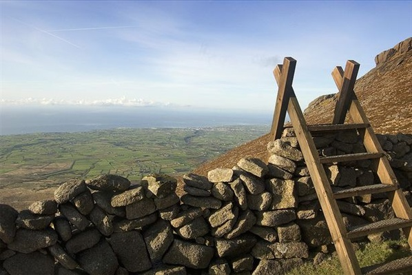 A stile crosses the wall on Slieve Binnian